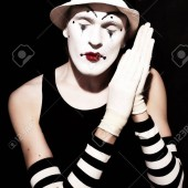 8092753-sleep-mime-in-white-hat-with-red-flower-on-a-black-background